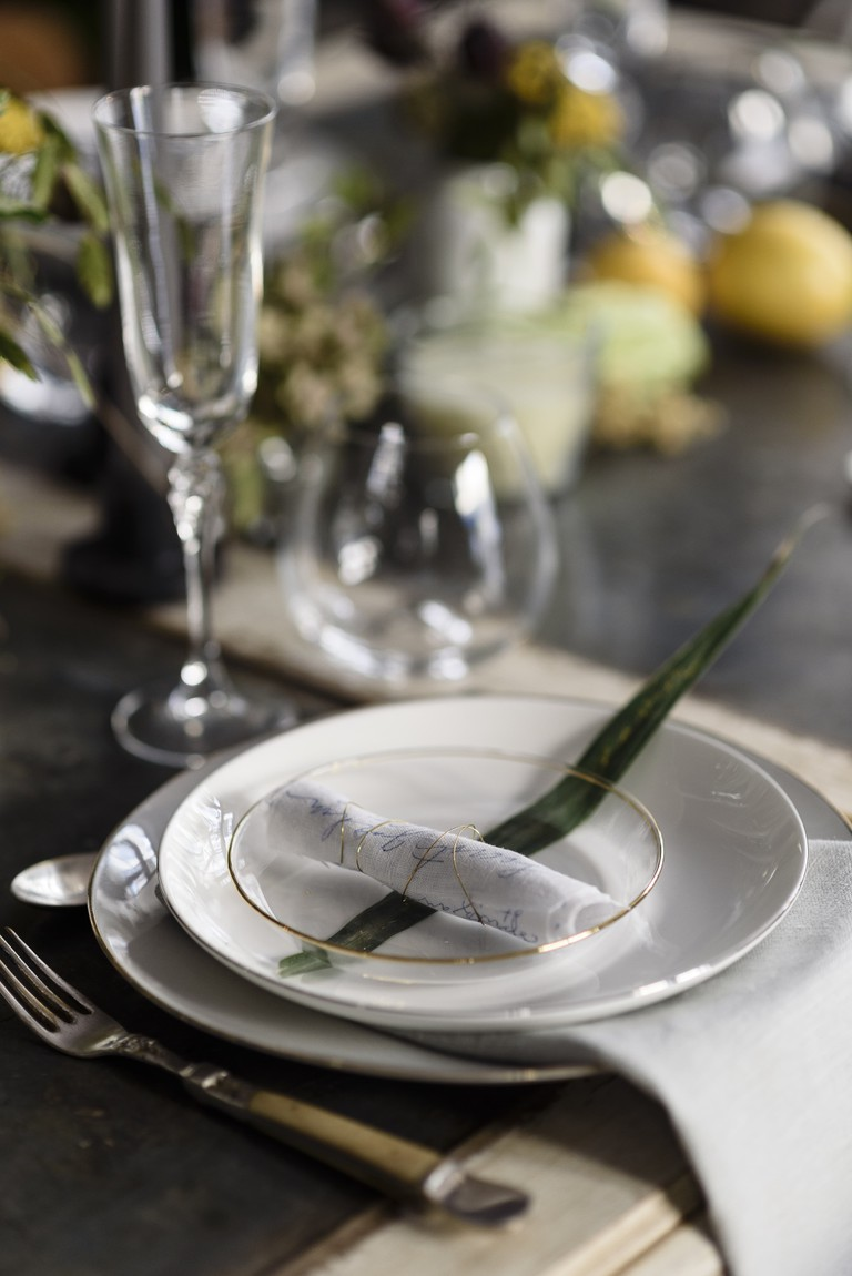 Hand-scripted menus and place cards made from leaves by calligraphy artist Nice Plume