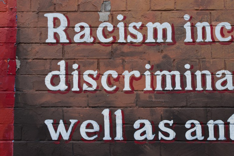 An anti-racism mural on a peace wall