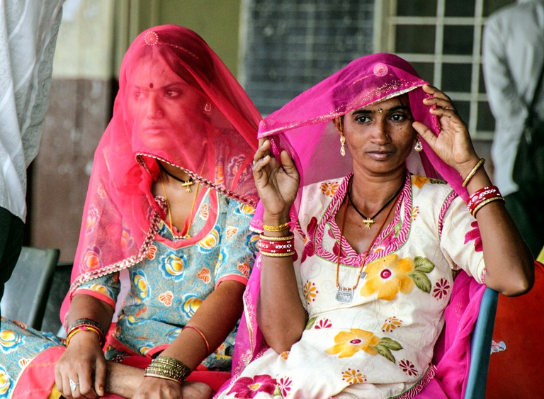 Women from Rajasthan covering face with odhni