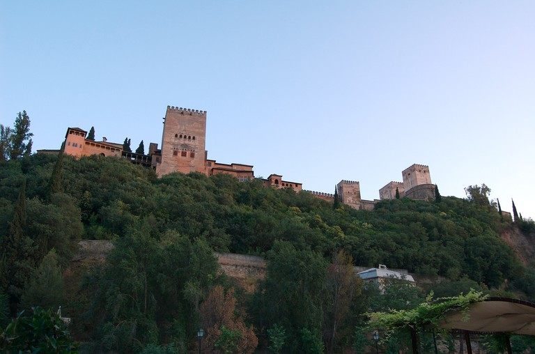 View of the Alhambra from the Paseo de Los Tristes, where mysterious underground tunnels can also be glimpsed; Macnolete, flickr