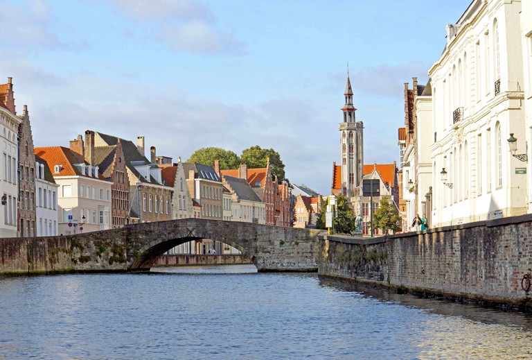The Burgher's Lodge slender tower peeking out in a picture-perfect Bruges' setting