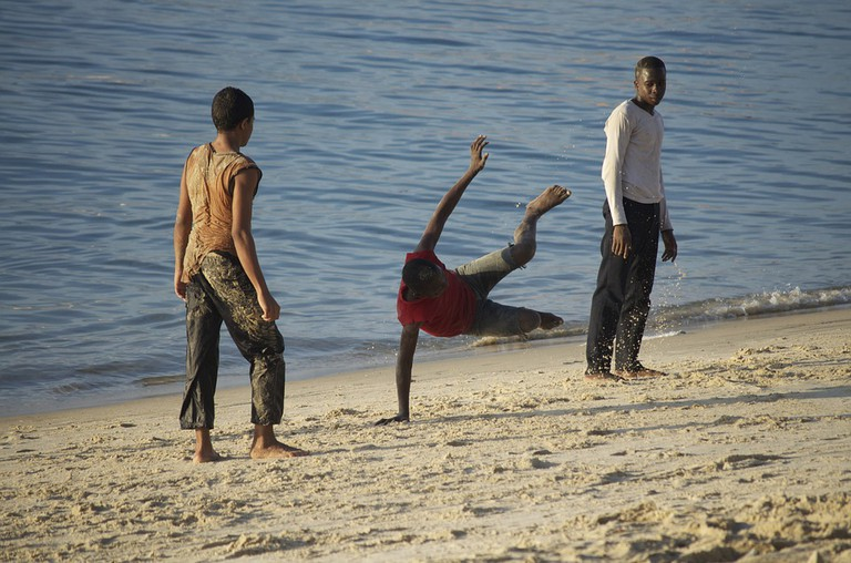 Young men practicing capoeira at a beach / http://maxpixel.freegreatpicture.com/Brazilian-Dances-Tanzania-Capoeira-Young-People-510620