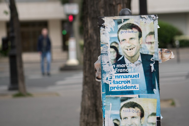 Defaced Macron election posters │© Lorie Shaull / Flickr