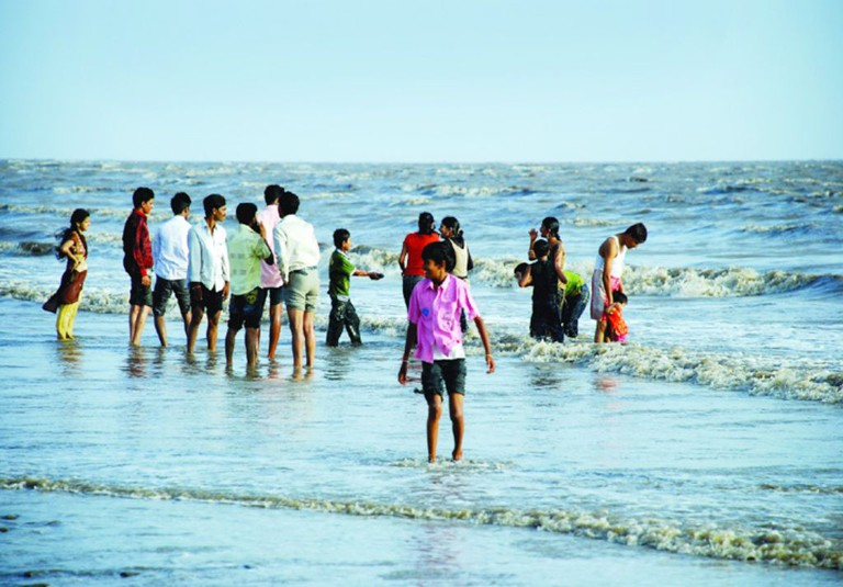 Tourists having fun at Dumas Beach