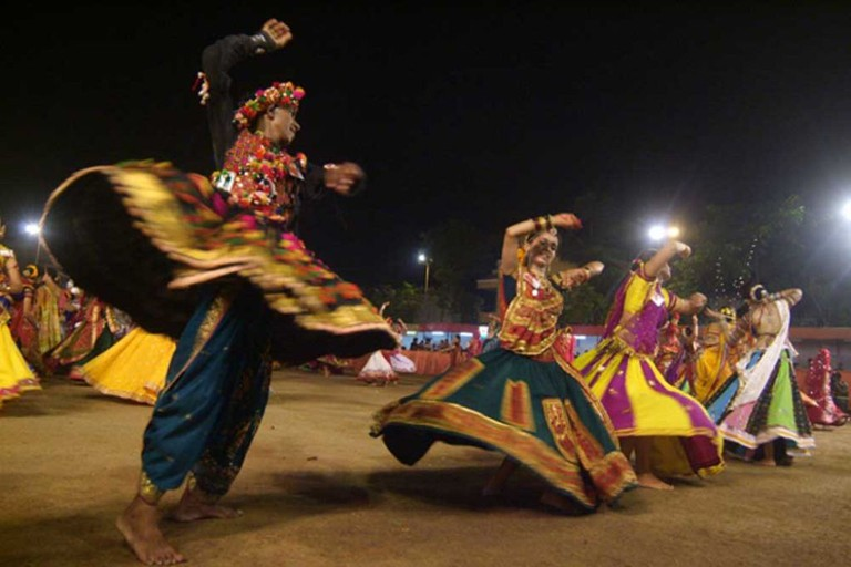 People dressed up in ethnic Gujarati costumes and performing Navratri Garba in Ahmedabad
