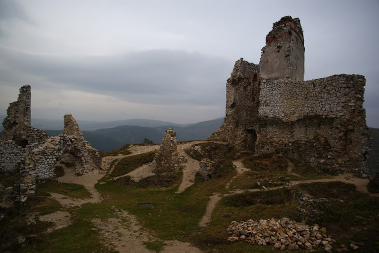 Čachtice Castle ruins with a view of the hills of the Carpathians beyond