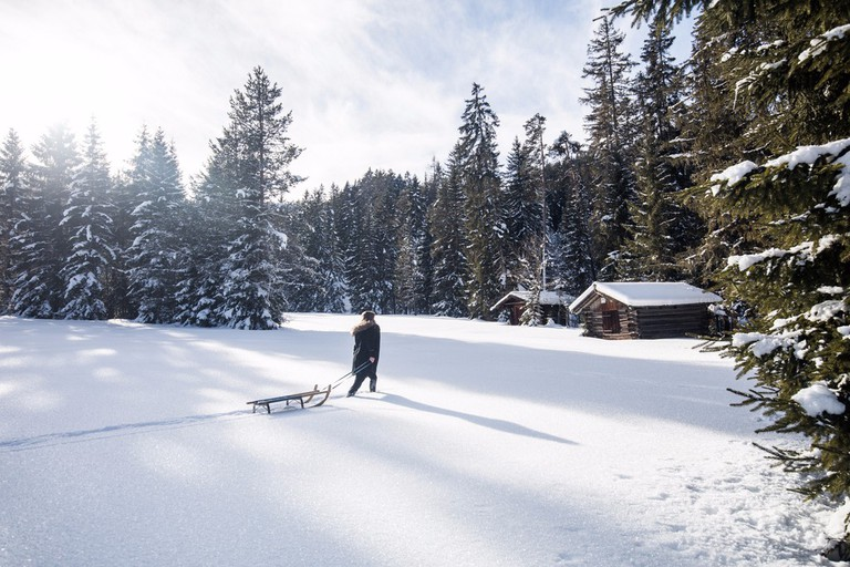 Go old-school and take a sledge up to the snowy mountains