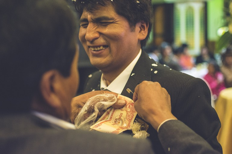 Pinning cash on the groom