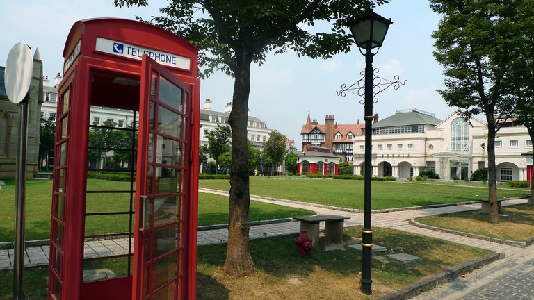 Red British-style telephone box in Thames Town, China