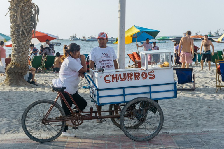 Grab some churros at El Chaco's beach
