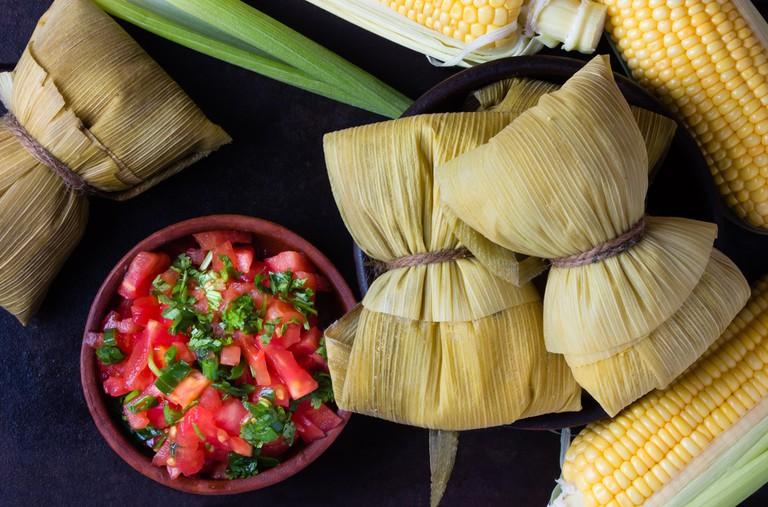 Homemade humitas served with salsa
