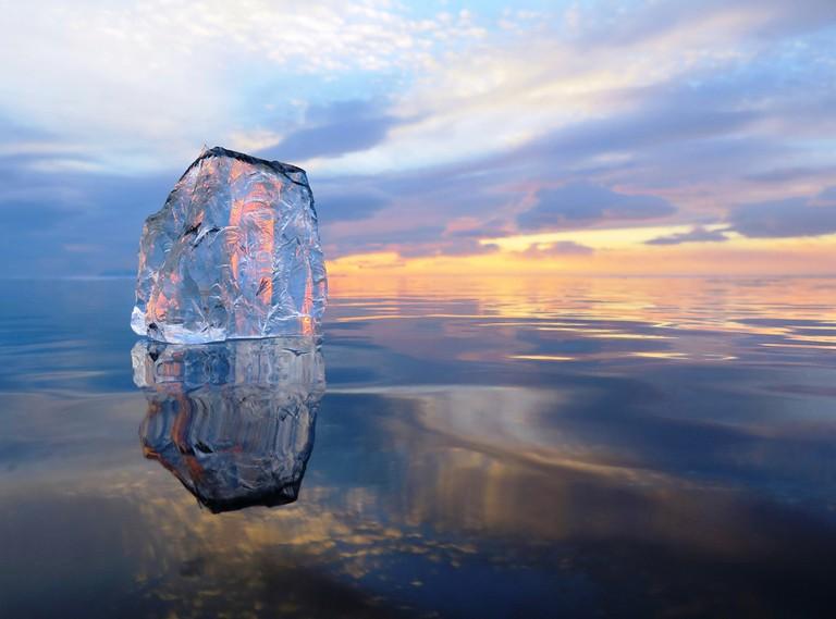 Ice on lake at sunset