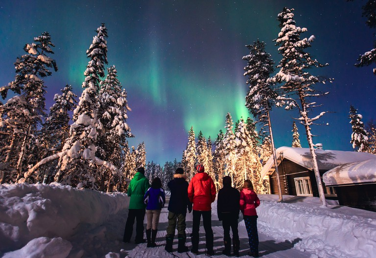 Northern Lights in the night sky over winter Lapland landscape, Norway, Scandinavia
