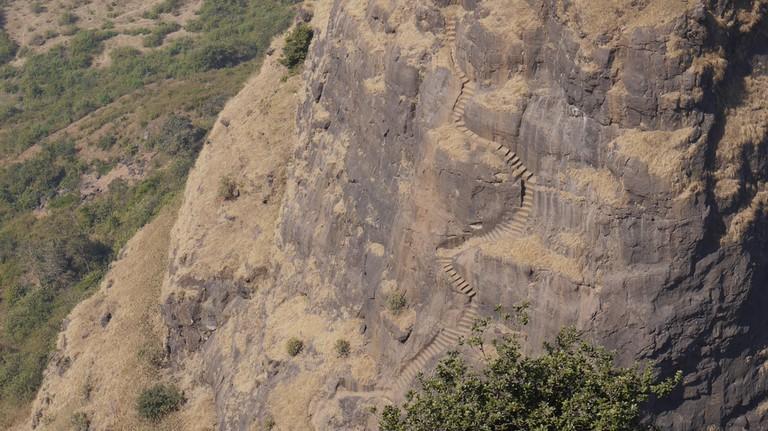 Zigzag steps carved into rocky mountains