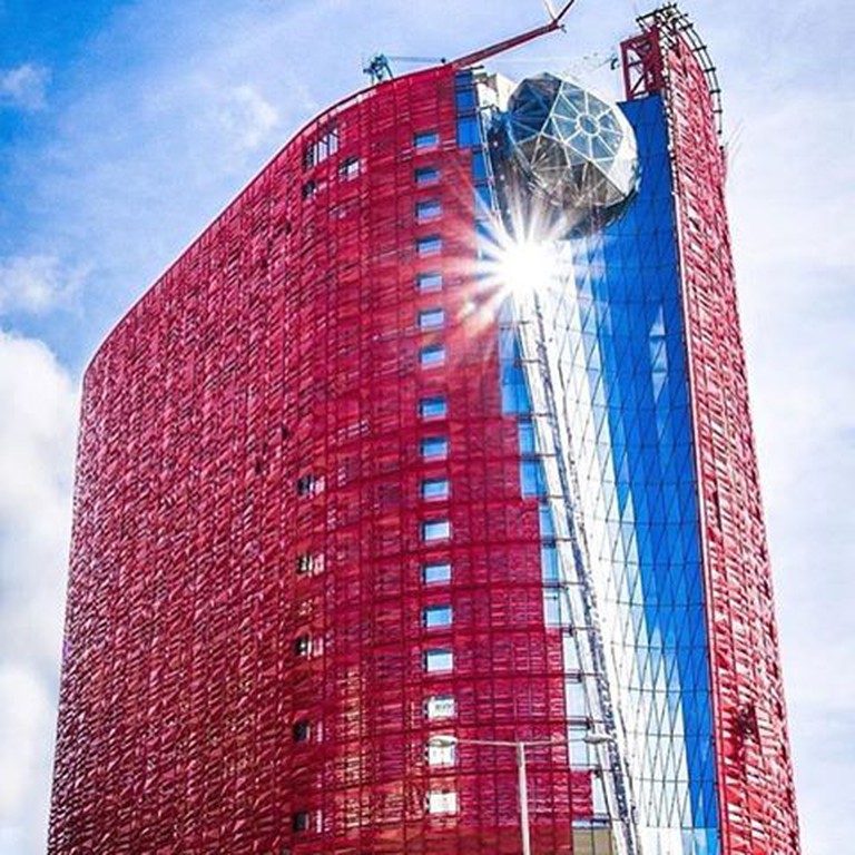The 13's striking exterior resembles a royal red robe wrapped around a crystal core, topped off with a 20-metre diamond I Courtesy of The 13 Holdings Ltd