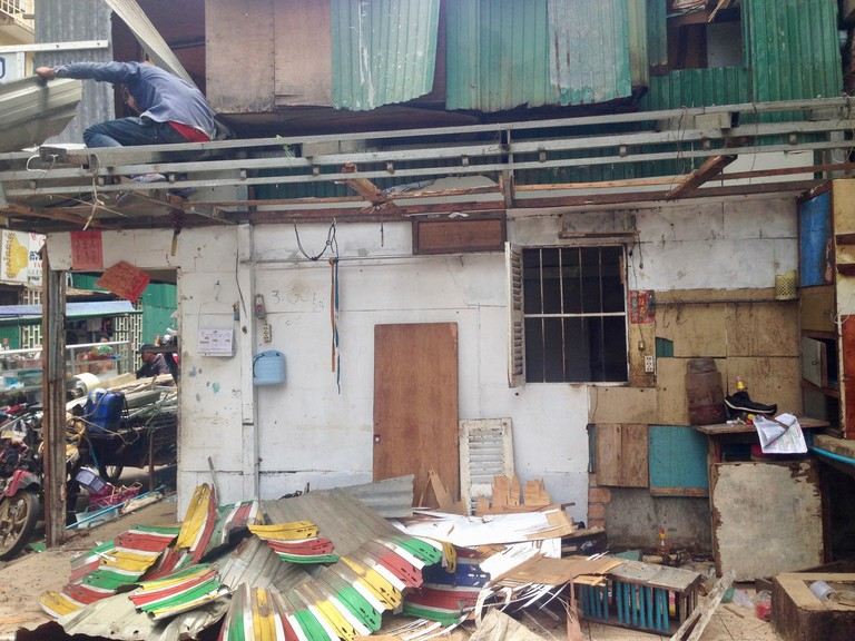 Residents dismantle their businesses and homes at The White Building