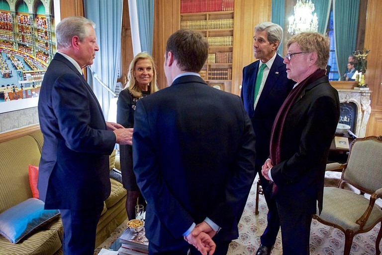 President Macron (who was Economy Minister at the time) at the COP 21 talking to Al Gore, John Kerry, the French Ambassador and Robert Redford
