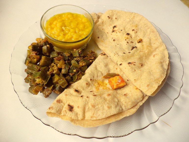 A small portion of dal, roti, and veggies