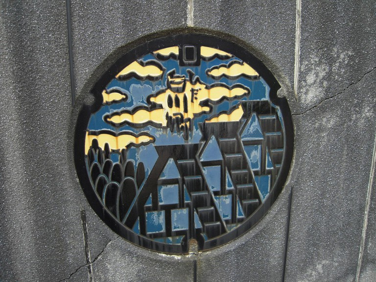 Manhole cover depicting UNESCO World Heritage Shirakawa-go Village