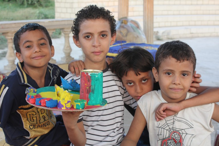 Egyptian children with their recycled art project