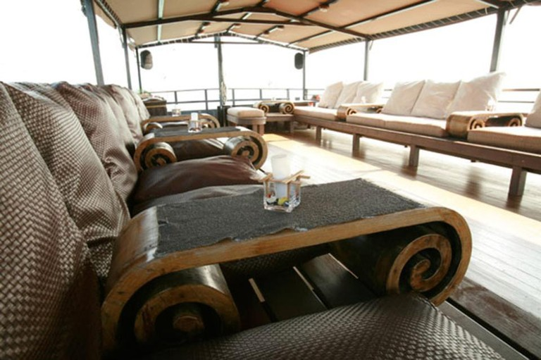 The Aqua Luna has two decks, including an open-air deck with loungers upstairs. Caption