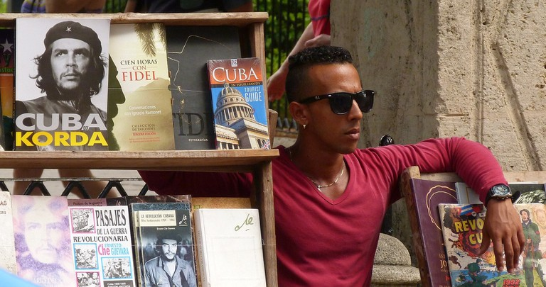 A man sells secondhand books in Cuba