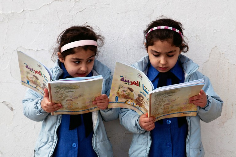 Kids reading in Jordan