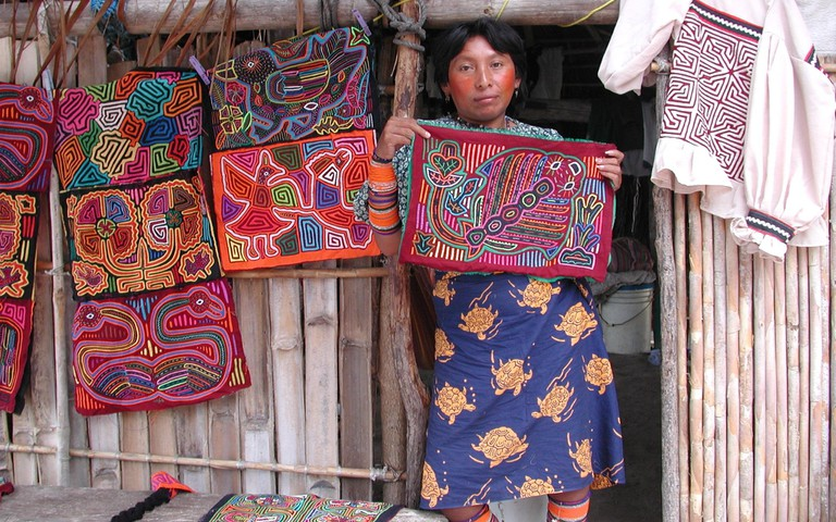 Guna Yala woman showcasing her molas (fabrics)