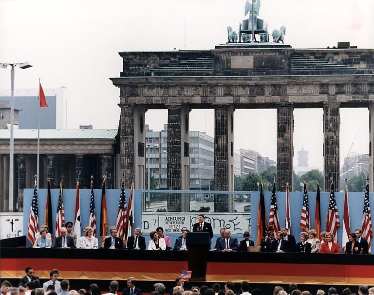 President Reagan giving a speech at the Berlin Wall, Brandenburg Gate, Federal Republic of Germany. June 12, 1987   Reagan White House Photographs / Wikimedia Commons