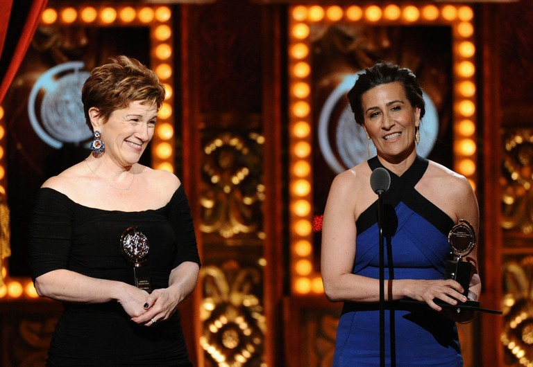 Lisa Kron, left, and Jeanine Tesori accept the award for best score for Fun Home at the 69th annual Tony Awards