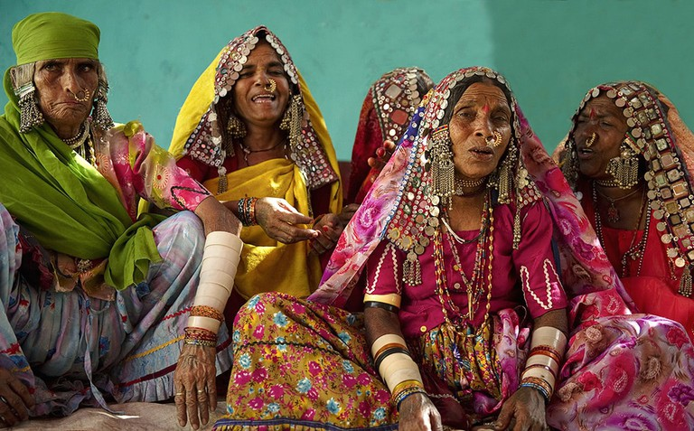 Tribal women in Kutch wear extremely colourful and heavily embroidered clothes