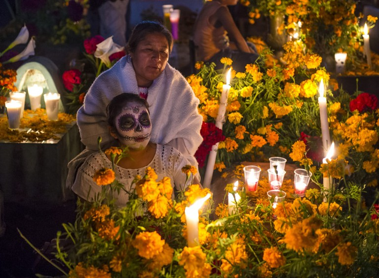 People on a cemetery during Day of the Dead in Oaxaca, Mexico