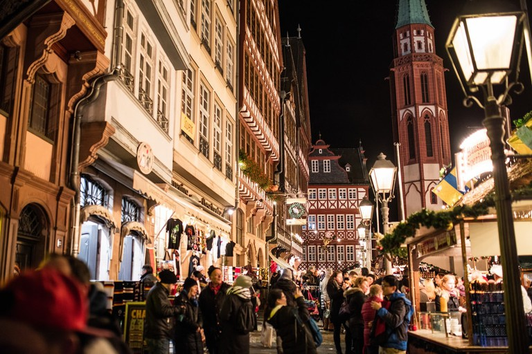 Visitors at a traditional Christmas market in Frankfurt, Germany | © J. Lekavicius/Shutterstock