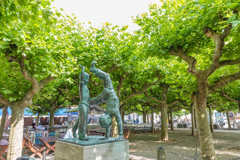Cartwheelers statue at Burgplatz in Dusseldorf, Germany