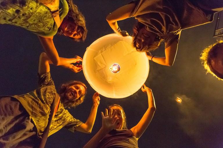 Friends releasing a lantern