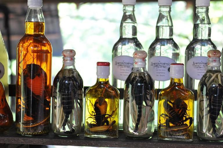 Line up of snake and scorpion whiskey bottles | © Shankar S./Flickr