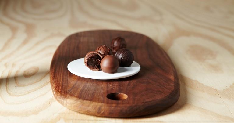 chocolate cake truffles on wood cutting board