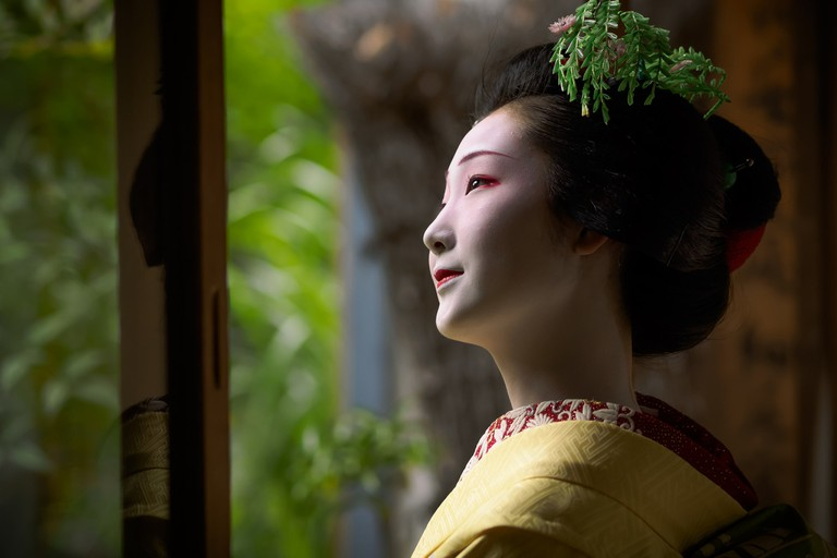 A maiko in full makeup and regalia