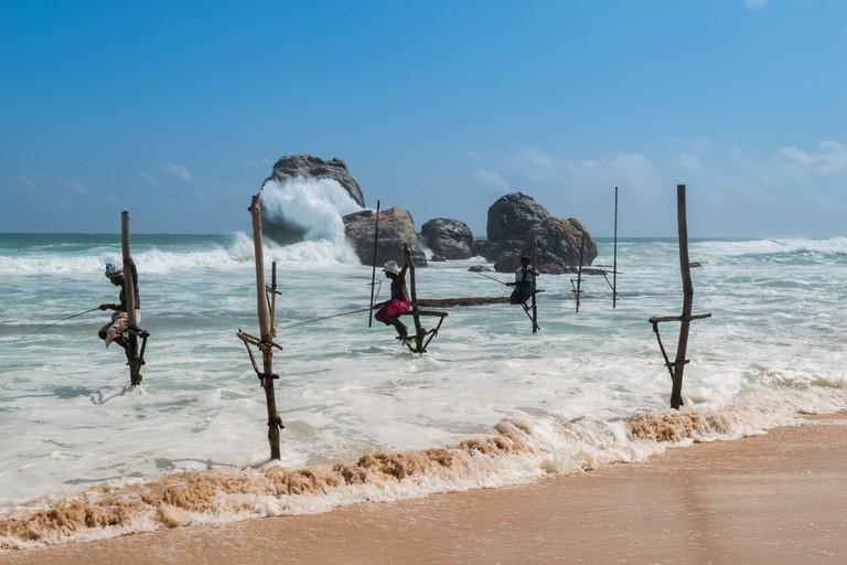 Stilt fishermen on the coast in Sri Lanka
