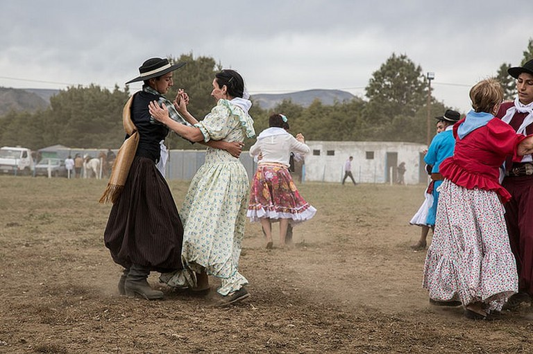 Dancing Pericón in traditional costume