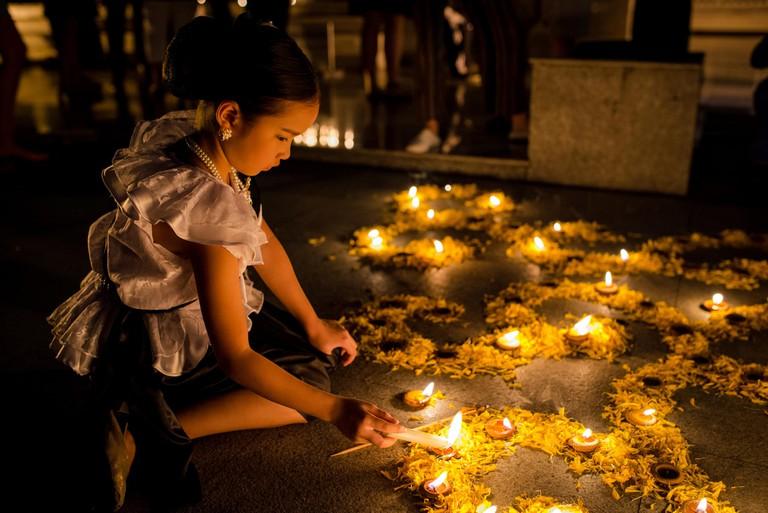 A girl lights candles