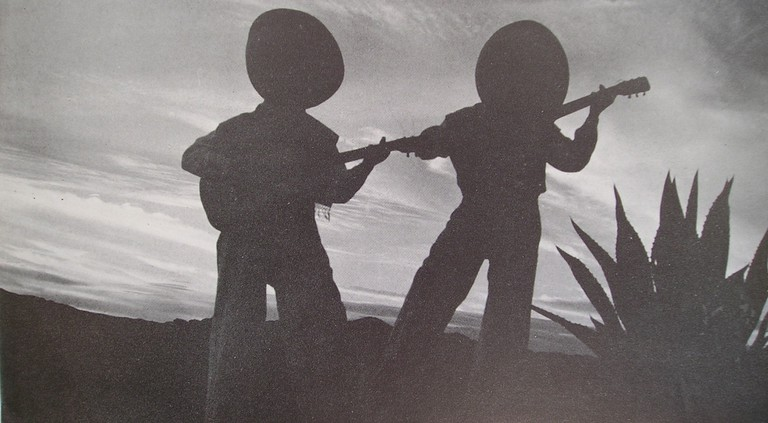 Two musicians playing the guitar