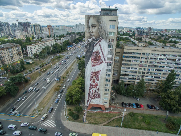 Aerial view of girl with embroidery in Kiev