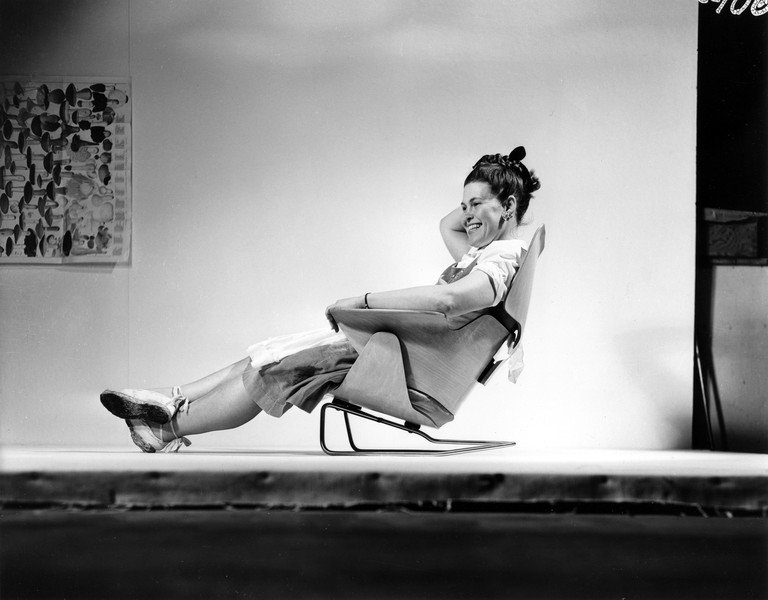 38. An Eames Celebration. Ray Eames sitting on an experimental lounge chair, 1946. ∏ Eames Office LLC_low