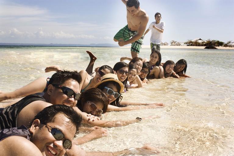 Filipino barkada at the beach