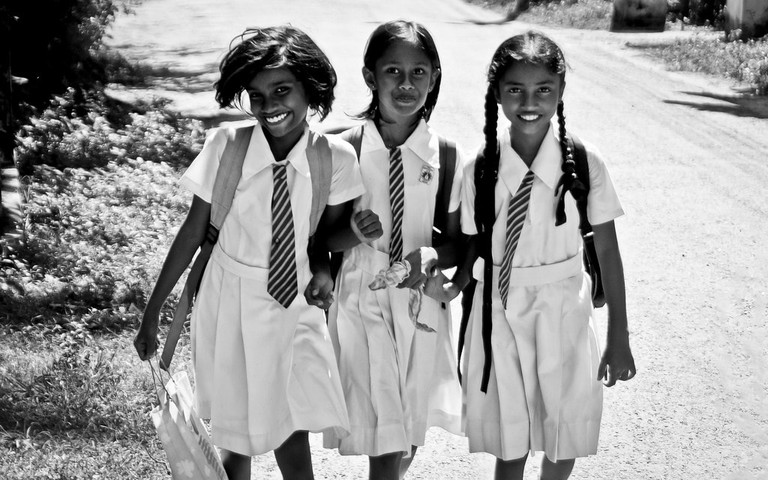 Smiling school girls in Mirissa, Sri Lanka