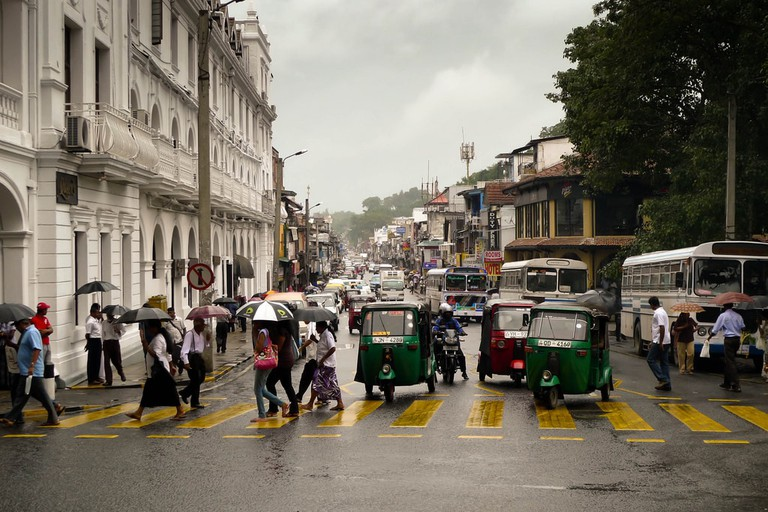 A rainy street crossing in Kandy, Sri Lanka