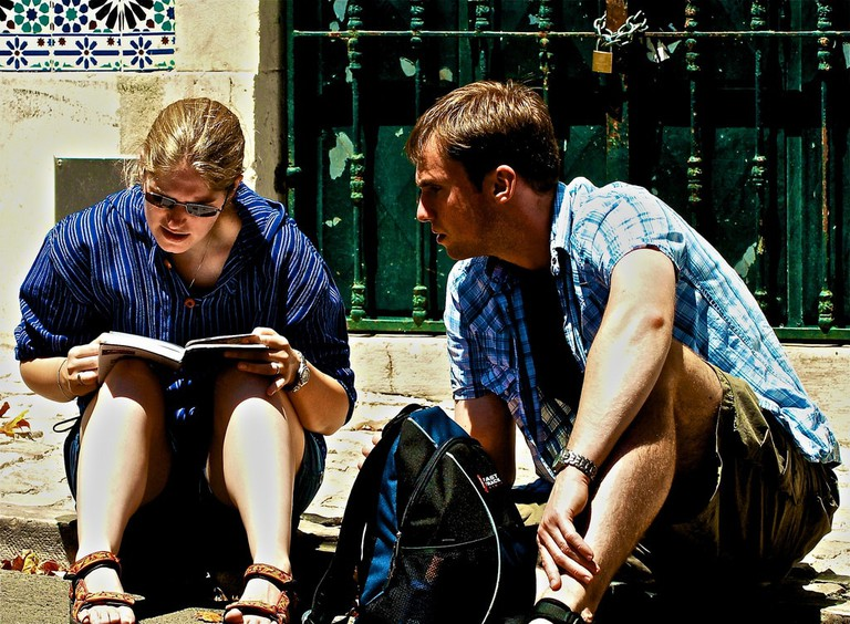 Tourists reading a travel guide