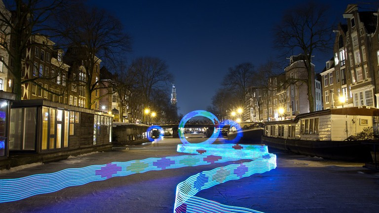 An illuminated artwork on Amsterdam's frozen Prinsengracht canal, placed there during the city's Light Festival