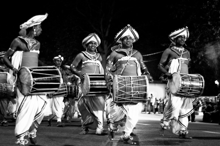 Perahera dancers and musicians on a Poya day celebration